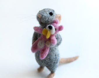 Gray needle felted mouse with a pink teddy bear