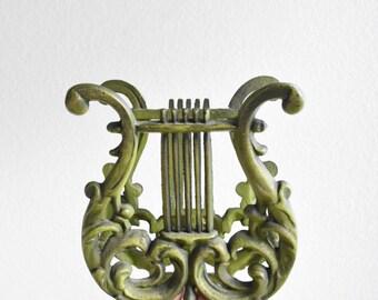 mid century metal green harp magazine holder / magazine rack