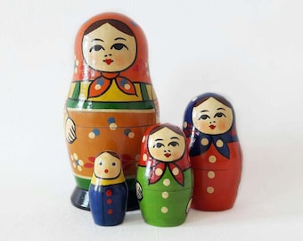4 Vintage Soviet Matryoshka Nesting Dolls