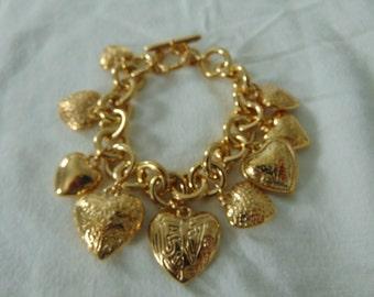 vintage hearts charm bracelet edwardian design gold tone toggle closure sighned JC
