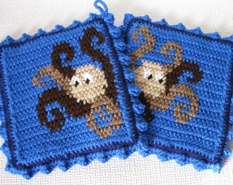 Octopus Pot Holders.  Blue, crochet potholders with beige and brown octopus.