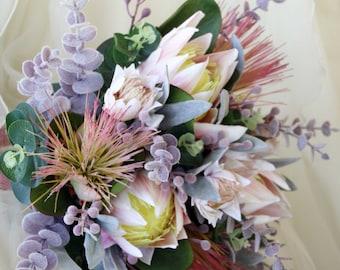 Rustic bouquet.  Wedding bouquet of native flowers.  Proteas, blushing bride, Australian native foliage. Pink, cream, flowers & musk foliage