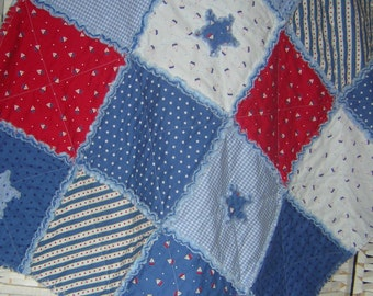 Blue, red and white rag quilt, throw. Boats, stars, dots, gingham. Cot quilt, baby boy blanket, lap quilt. All cotton. Snuggly soft.
