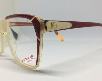 Vintage Paco Rabanne red/white frames with golden detail and original demo lenses