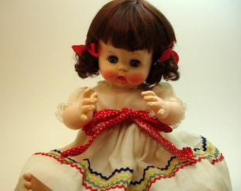 Effanbee 1968 blink & drink vinyl doll no. 14, 2500, in original dress with diaper