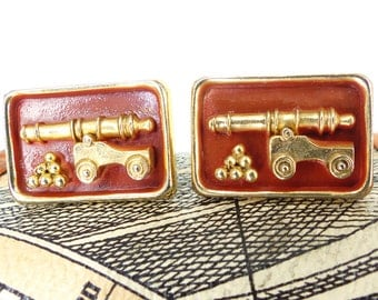 Too darn cool Anson cannon balls and cannon set of cufflinks, relief design, set in rust & gold. Squared hardware style.