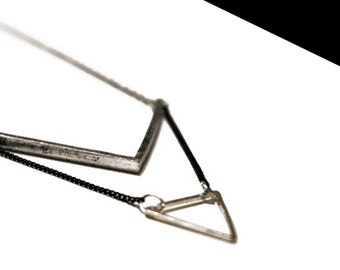 Silver triangle necklace.