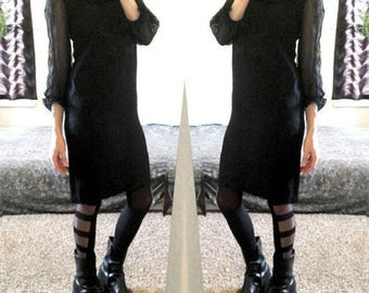 Vintage 60s black ruffle trim dress, arms are sheer, zips in back