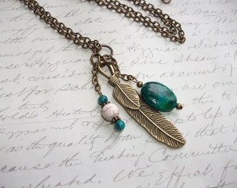 Long feather charm antique brass / bronze necklace with chrysocolla and howlite stones