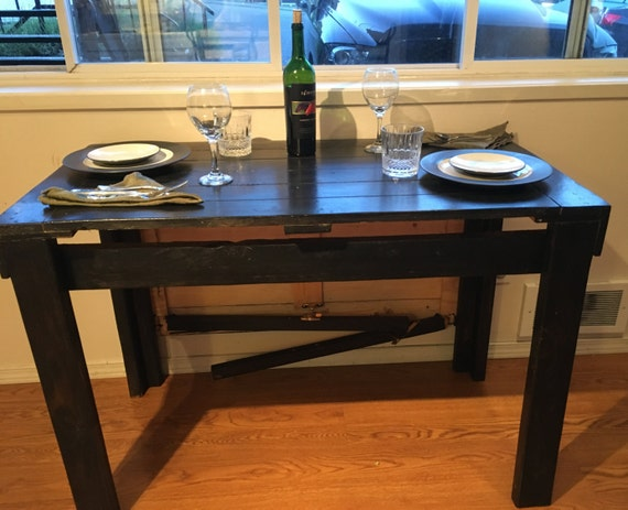 Kitchen table reclaimed pallet board table drop down table for Pull down kitchen table