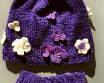 Knitted beanie with felted flowers.