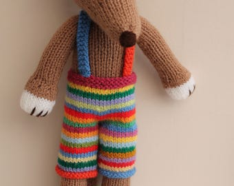 Handmade hand knitted soft toy dog called Diggerdy Dog. He is a lovely cuddly toy. ideal gift for any age.