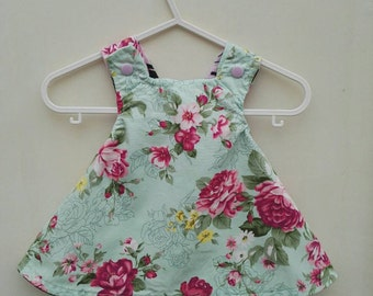 Handmade reversible crossover back baby dresses in various sizes, choose your own fabric.