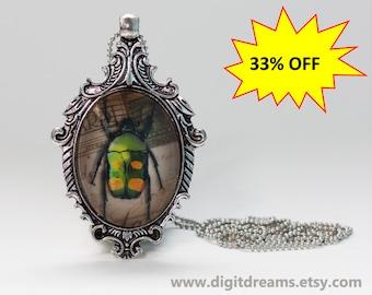Ma14: Green-Orange Beetle antique style pendant/keychain
