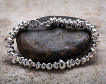 Bracelet with silver bowls