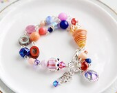 Quirky Nook: Peach Navy Blue Purple Multi-Strand Beaded Charm Bracelet with 12mm Swarovski Crystal Paradise Rivoli and Handmade Lampwork