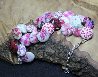 Hand made, upcycled, fabric button bracelet, Vintage pink various patterns