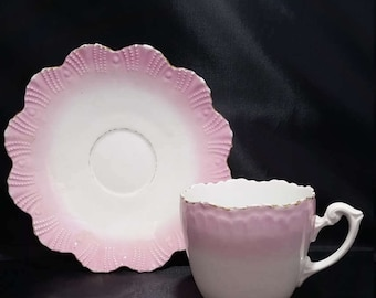 A Vintage Pink Porcelain Teacup and Saucer Made in Germany.