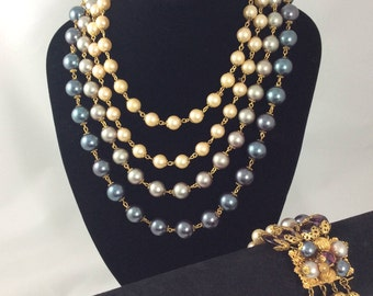 Classic Vintage 1950s ' KRAMER ' signed three piece set...featuring faux pearl necklace, earrings and bracelet.