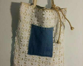 handmade bag with lace and a denim pocket