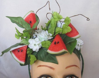 Delicious Watermelon Slices and Field Greens with White Spring Flowers Fascinator
