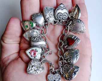 Vintage 1940's puffy heart charm bracelet 13 repousse enamel and guilloche hearts sterling silver Walter Lampl padlock loaded