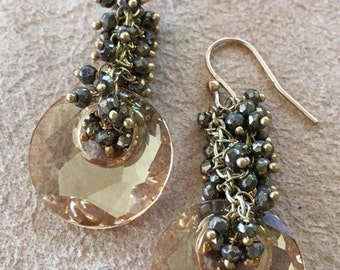 Earrings of Swarovski champage crystal disks with marcasite and pyrite beads on 14k gold vermeil chain, faceted,reflexive, gypsy spirit.