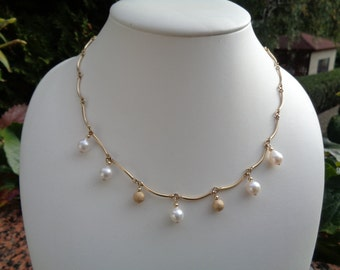 Chain in 585-er gold Akoya pearls and Stardust beads, curved rods