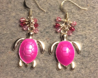 Bright pink enamel turtle charm dangle earrings adorned with tiny dangling pink Czech glass beads.