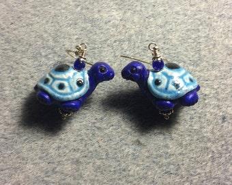 Dark blue and light blue ceramic turtle bead earrings adorned with dark blue Czech glass beads.