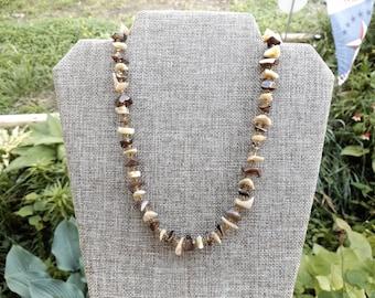 Stone beaded necklace, heavily polished.