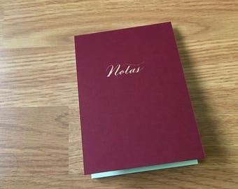 Notes notebook with golden calligraphy