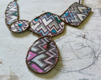 Light necklace made with blue-gray fabric