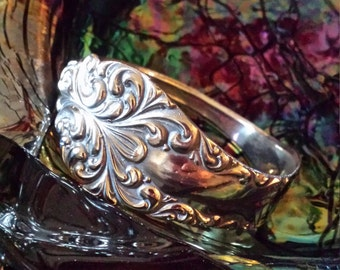 Sterling silver scrolling solid bangle