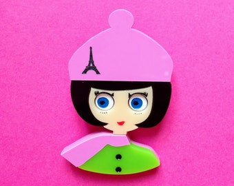 Lilac and green girl acrylic brooch, NICOLE wears a Eiffel tower printed beret and a scarf, with a green buttoned coat