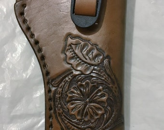 Hand tooled leather revolver holster-medium- Made in Montana(adjustable strap, custom designs)