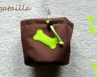 Brown dog treat pouch with a colourful bone
