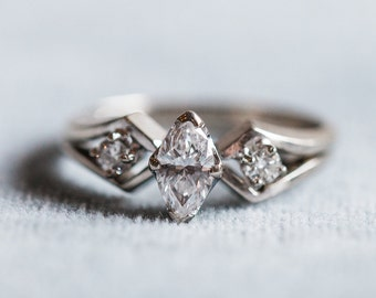 Vintage Marquise cut .5 carat engagement ring with wedding band in 14 karat white gold