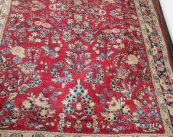 Antique Persian Sarouk Oriental Rug.