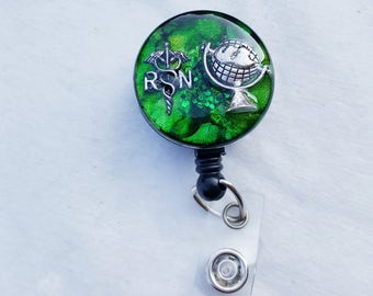 Travel nurse name badge holder with a green background and RN caduceus, globe detail