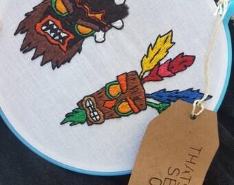 Aku aku and uka uka embroidery