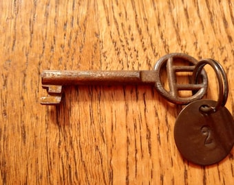 Iron Hotel Room Key with Brass Room Number Tag