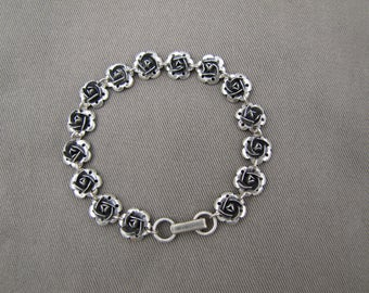 Sterling silver tiny roses bracelet