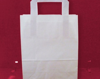 White paper bags with flat handles for gift wrapping