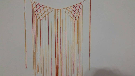 Orange, red and white macrame wall or window hanging