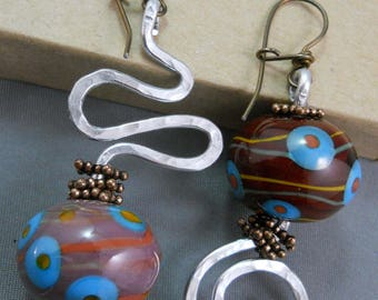 Asymmetrical aluminum & brown hollow blown beads with blue and orange design earrings