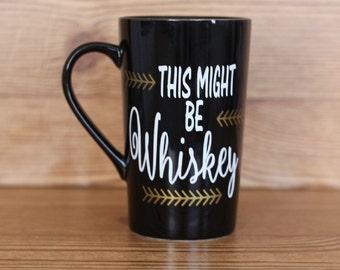 This might be whiskey, might be whiskey mug, coffee mug, coffee cup