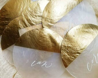Metallic gold capiz shell place cards with romantic, modern calligraphy - natural, seashell beach