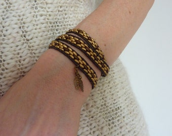 Wrap bracelet with gold and bronze beads and leather