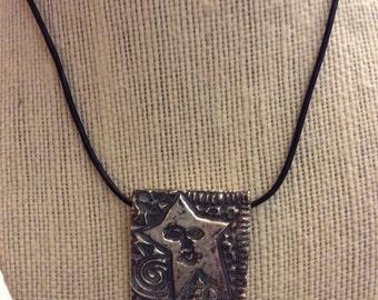 Fine silver abstract  face pendant